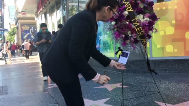 fans of mary tyler moore pay their respects to the actress as flowers are laid in honor at her star on the hollywood walk of fame - schauspielerin stock-videos und b-roll-filmmaterial
