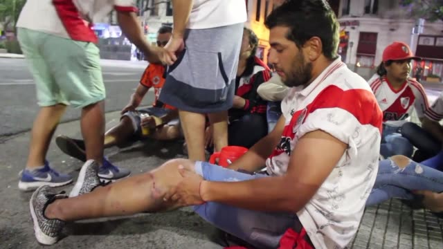 Fans of River Plate threw bottles and police responded with gas and rubber bullets late on Sunday in central Buenos Aires after the team's victory in...