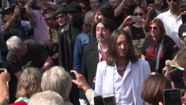fans of the beatles gather to cross the famous abbey road zebra crossing and sing beatles songs on the 50th anniversary of the the iconic photo of... - david minchin stock videos & royalty-free footage