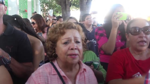 fans of the mexican singer juan gabriel gather in front of his house in juarez to pay tribute to the legendary singer and producer who died after a... - monica singer stock videos & royalty-free footage