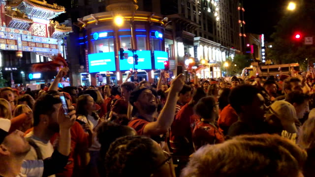 Fans of the Washington Capitals celebrate in the Chinatown area near Capital One Arena after the hockey team won the Stanley Cup June 7 2018 in...