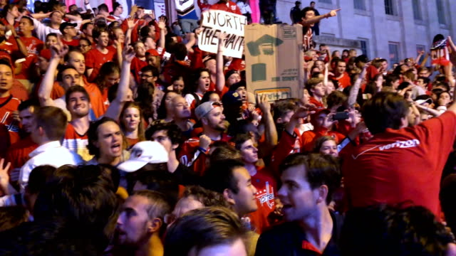 Fans of the Washington Capitals celebrate outside Capital One Arena after the hockey team won the Stanley Cup June 7 2018 in Washington DC The...