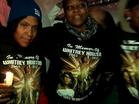 fans outside funeral parlor screaming wearing whitney houston shirts. there is a closeup of a group of fans wearing whitney houston t-shirts and... - new age stock videos & royalty-free footage