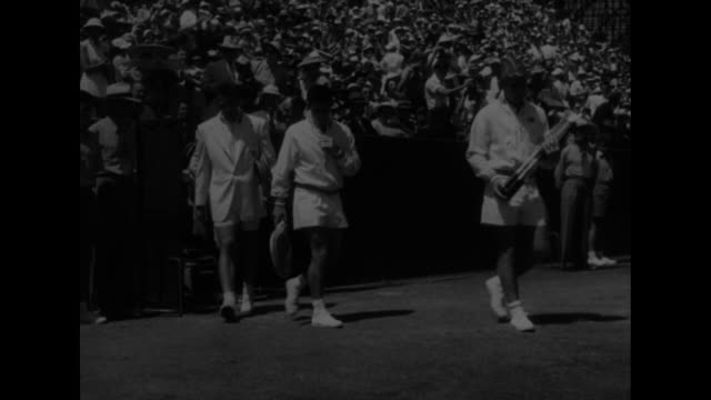fans / pan stadium / doubles players walk onto court / australians lew hoad and ken rosewall, americans vic seixas and tony trabert / foursome plays... - davis cup stock videos & royalty-free footage