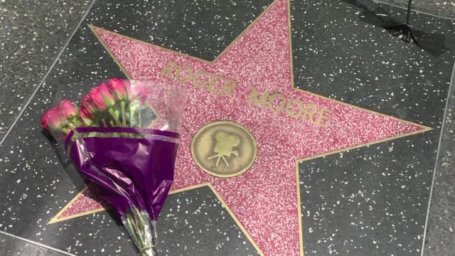 Fans pay tribute to the late Roger Moore on the Walk of Fame in Los Angeles where the legendary James Bond actor received a star in 2007