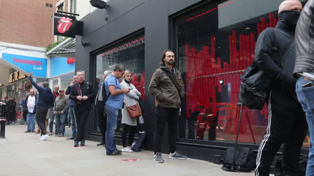 fans queueing outside newly opened rolling stones store. the flagship store opened on carnaby street in london, uk, on wednesday, september 9, 2020. - outdoors stock videos & royalty-free footage