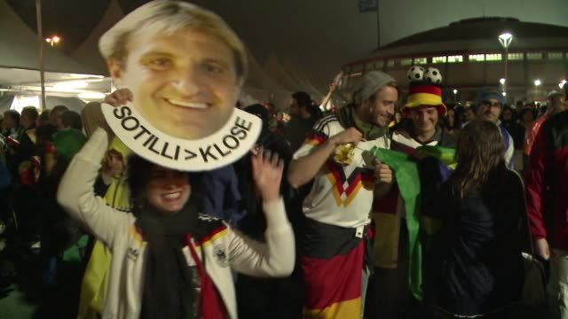 fans react to germanys 21 victory over algeria in extra time to book a place in the world cup quarter final - brasile meridionale video stock e b–roll