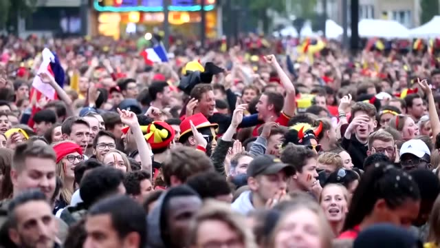 fans react while watching the broadcast of the 2018 fifa world cup russia semi final soccer match between france and belgium on july 10, 2018 in... - fan enthusiast stock videos & royalty-free footage
