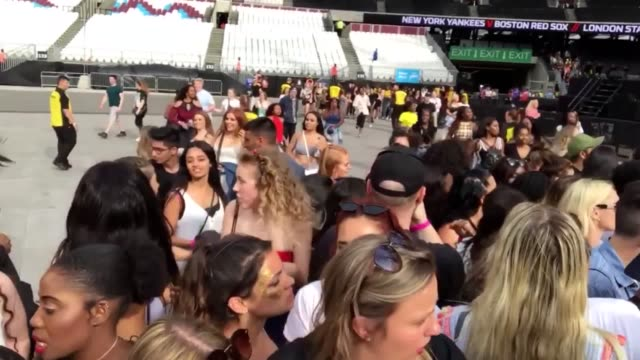 fans run into the london stadium in stratford ahead of tonight's beyonce and jayz concert - beyoncé knowles stock videos & royalty-free footage