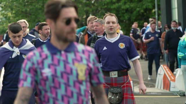 fans sing and cheer as they arrive at hampden stadiumahead of tuesday night's euro 2020 group stage game against croatia at hampden stadium on june... - lifestyles stock videos & royalty-free footage