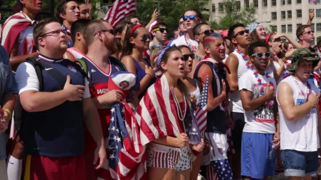 S fans sing the US national anthem during a viewing party of the World Cup United States vs Belgium match at the Freedom Plaza Washington DC July 1...