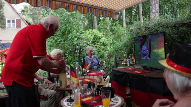 """fans sitting in a private garden in district berlin-zehlendorf sing """"final"""" on the uefa euro 2020 match between portugal v germany on june 19, 2021... - senior women stock videos & royalty-free footage"""