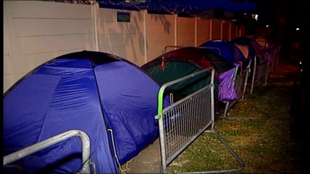 Fans sleep overnight to get tickets for first day of Wimbledon ITN London Wimbledon Tents barriers on pavement people asleep on pavement / GVS tents...