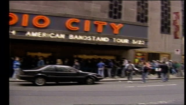 fans standing in line outside radio city music hall - radio city music hall stock videos & royalty-free footage
