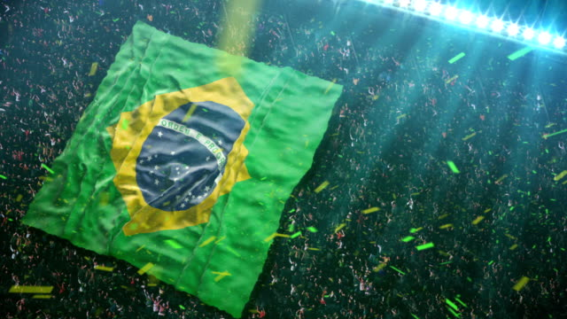 fans unfurl majestic flag of brazil at the stadium - american football ball stock videos & royalty-free footage