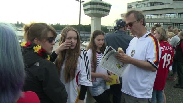 fans waited at berlins tegel airport to greet germanys world cup winners - sportweltmeisterschaft stock-videos und b-roll-filmmaterial