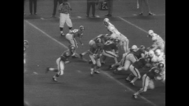 fans walking into the astrodome in houston / live cougar sits in a wagon / game begins / specific players mentioned are george nordgren art mcmahon... - ncaa college football stock videos and b-roll footage