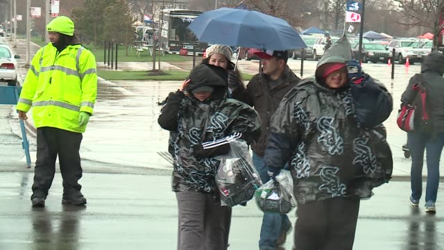 WGN Fans Walking Through Rain and Snow at Outside US Cellular Field on the White Sox Opening Day on April 8 2016