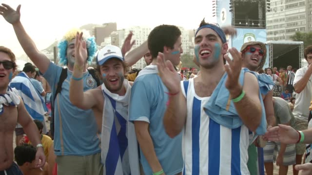 fans watch argentina beat bosnia and herzegovina 2-1 in world cup play on the large screen setup at fifa world cup fan fest on copacabana, beach, on... - argentina stock videos & royalty-free footage