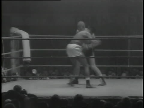 fans watch as middleweight boxer sugar ray robinson wins in the eighth round by a knockout. - boxing stock videos & royalty-free footage