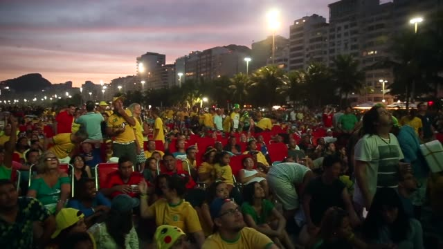 fans watch brazil beat cameroon 4-1 in world cup play on the large screen setup at fifa world cup fan fest on copacabana, beach, on the 23rd of june,... - international team soccer stock videos & royalty-free footage