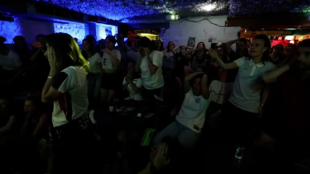 fans watch england's women's world cup defeat to the usa at book club bar in shoreditch the lionesses lost the semifinal in lyon france 21 - book club stock videos & royalty-free footage