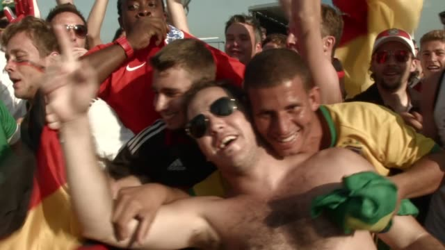 fans watch germany beat portugal 4-0 in world cup play on the large screen setup at fifa world cup fan fest on copacabana, beach, on the 16th of... - fußballweltmeisterschaft stock-videos und b-roll-filmmaterial