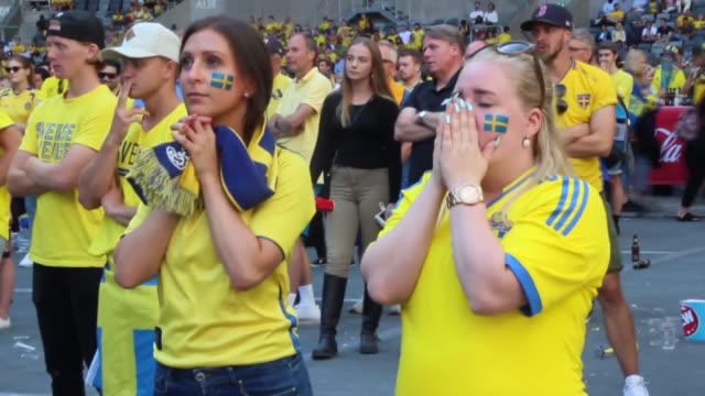 fans watch the 2018 fifa world cup russia quarter final match between sweden and england on a giant screen at tele2 arena in stockholm sweden on july... - fifa world cup stock videos & royalty-free footage