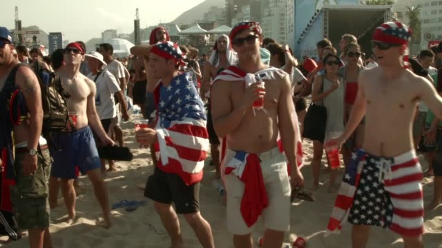 fans watch the usa beat ghana 2-1 in world cup play on the large screen setup at fifa world cup fan fest on copacabana, beach, on the 16th of june,... - international team soccer stock videos & royalty-free footage