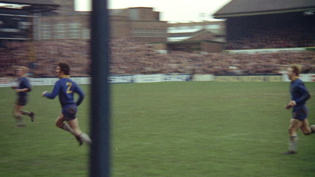 1973 MONTAGE Fans watching rugby game between Warrington Wolves and St Helens Saints / England, United Kingdom
