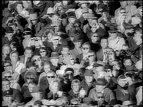 vidéos et rushes de fans with sunglasses + binoculars at army vs. navy football game / philadelphia / newsreel - philadelphie