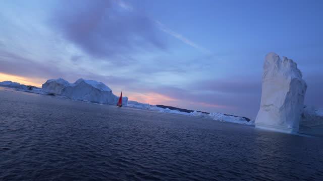 fantastic iceberg and ship at sunset - disko bay, greenland - majestic stock videos & royalty-free footage