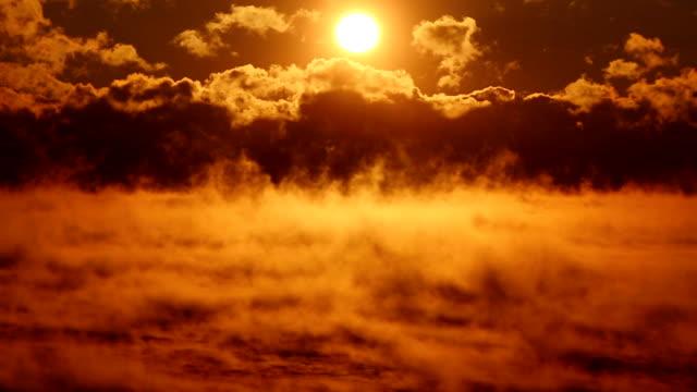 fantastic sunset over the misty sea