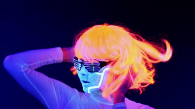 Fantastic video of sexy cyber raver woman filmed in fluorescent clothing under UV black light.Sexy girl cyber glow raver women filmed in fluorescent clothing under UV black light,party concept