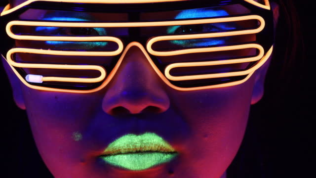fantastic video of sexy cyber raver woman filmed in fluorescent clothing under uv black light.sexy girl cyber glow raver women filmed in fluorescent clothing under uv black light,party concept - vibrant color stock videos & royalty-free footage