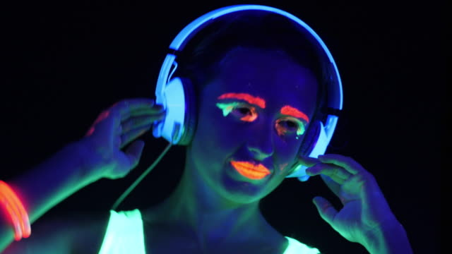 Fantastic video of sexy cyber raver woman filmed in fluorescent clothing under UV black light.Sexy girl cyber glow raver women filmed in fluorescent clothing under UV black light,party concept