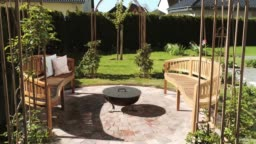 Fantastically beautiful garden with fire pit and rose arches
