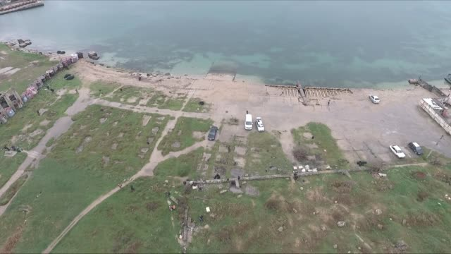 far drone shot that flies over the shores of sevastopol crimea and eventually to the water's edge - sevastopol crimea stock videos and b-roll footage