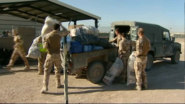 christmas parcels sent to british forces by well wishers afghanistan ext bags of christmas post loaded onto trailer and into back of jeep by soldiers - trailer home stock videos & royalty-free footage