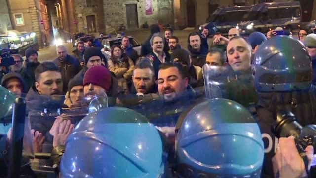 Far right party Forza Nuova supporters clash with police in Macerata central Italy where an Italian man is accused of shooting six African migrants...