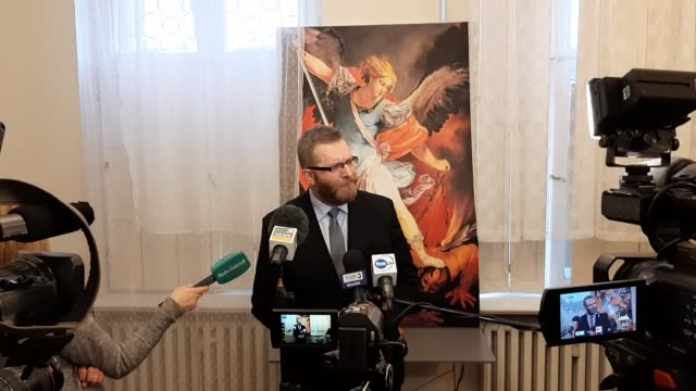 Far right politician and movie director Grzegorz Braun speaking to media in front of Saint Michael the Archangel painting is seen in Gdansk Poland on...