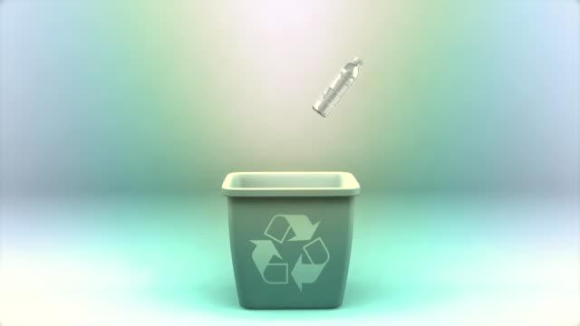 Far view of falling water bottles and recycling bin
