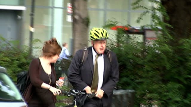 farage may contest south thanet seat in general election t06081403 boris johnson along wheeling bicycle and wearing cycle helmet - bicycle seat stock videos & royalty-free footage