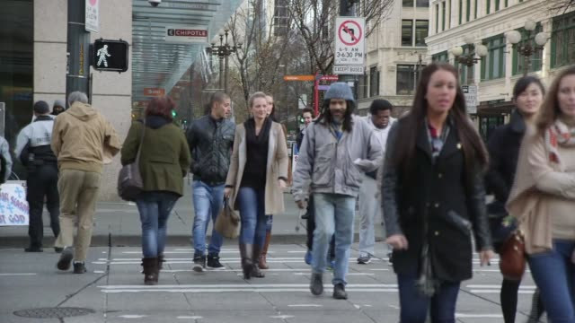 fare enforcement and others cross busy seattle intersection switch to pike place market and people walking about - pike place market stock videos and b-roll footage