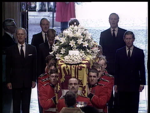 Farewell to a Princess c Ceremony London Westminster TMS Pallbearers of Welsh Guards carry coffin into Westminster Abbey followed by Prince Philip...