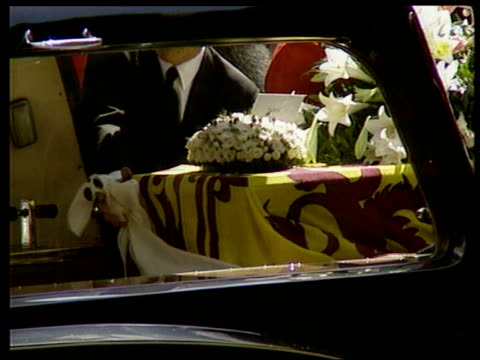 farewell to a princess itn cms lighted candle held aloft coffin being put into hearse frances shandkydd watching as hearse away princes charles... - frances shand kydd stock videos & royalty-free footage