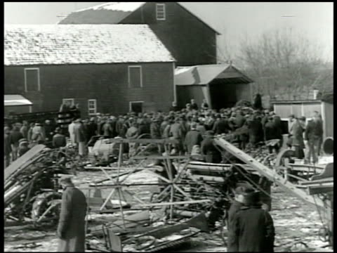 stockvideo's en b-roll-footage met farm auction inspection many people standing in group near farmhouse barn farm machinery fg poster'public sale farm machinery' vs farmers looking at... - 1943