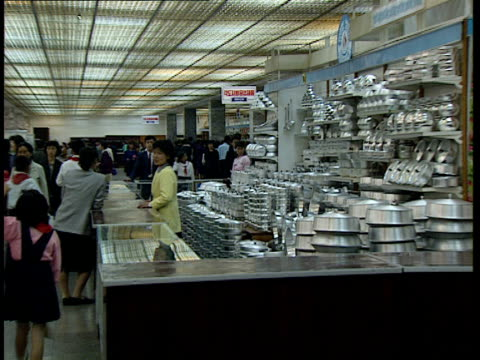 farm / department store / station / gymnastics display / pyongyang views / pyongyang maternity hospital int people buying goods in large store... - remote controlled stock videos and b-roll footage
