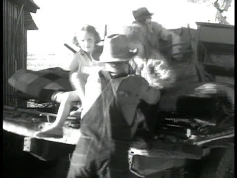 farm family loading wagon by desert barn ms man lifting girl boy children onto wagon wagon driving away horse drawn wagon ms trailer w/ 'no more... - great depression stock videos & royalty-free footage