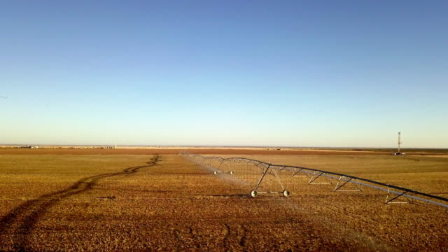 farm irrigation sprinkler system and fracking drill rig - irrigation equipment stock videos & royalty-free footage